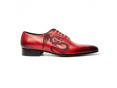 red patinated One cut oxford with a laser dragon